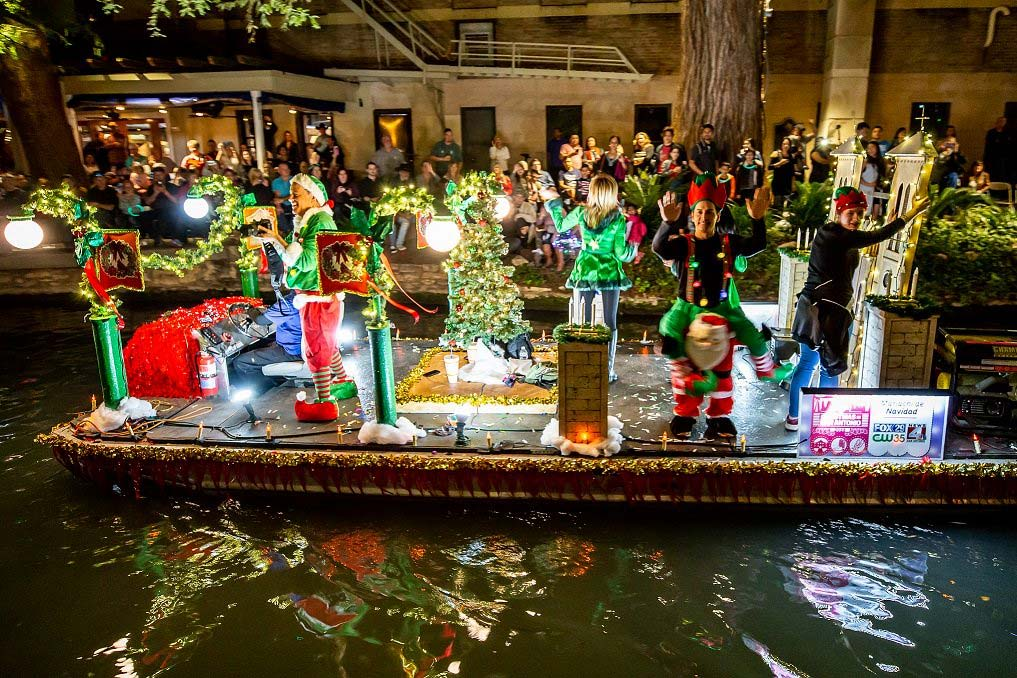 Elves waving from a river float