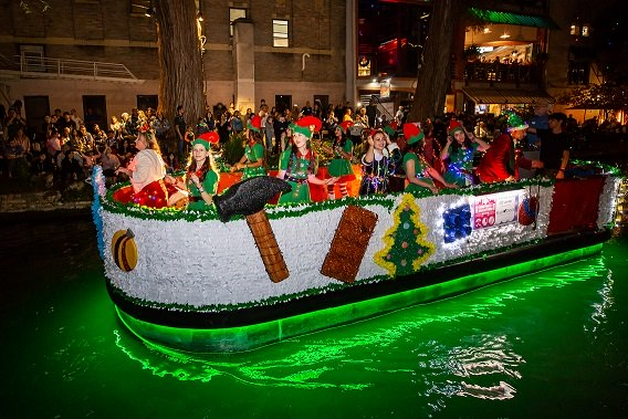 River float with elves in the Ford Holiday River Parade